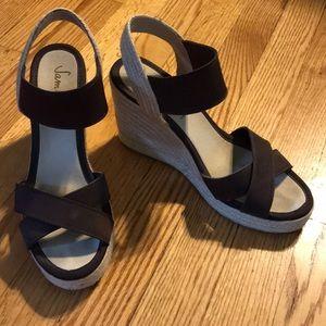 Brown fabric wedge espadrille sandals.